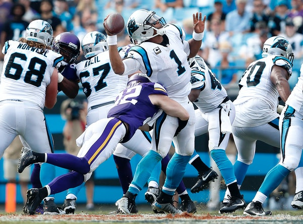 Cam Newton (1) was sacked by Harrison Smith (22) in the fourth quarter.