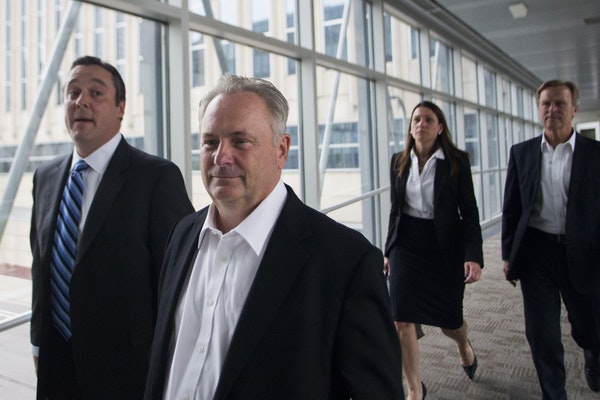 Former Starkey president Jerome C. Ruzicka and former Starkey human resources manager Larry W. Miller (far right) left the Federal Courthouse on Frida