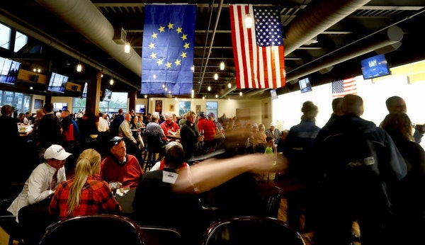 Team USA and Team Europe Ryder Cup flags hung at the Crooked Pint Ale House in Chaska. The city organized two promotional events to keep people in Cha