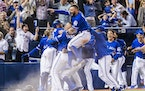 Toronto Blue Jays players celebrate their walk-off win to eliminate the Texas Rangers during the tenth inning to win the American League Division Seri
