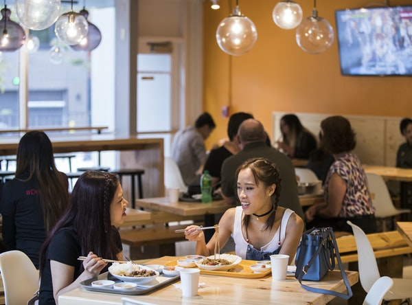 Van Nguyen, left, and Hannah Luong enjoyed lunch at K-Bop Korean Bistro, one of several new restaurants near the University of Minnesota.