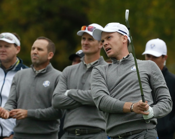 Europe's Danny Willett watches his drive with teammate Justin Rose and Sergio Garcia during a practice round for the Ryder Cup Wednesday.