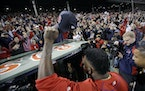 Boston Red Sox's David Ortiz salutes the crowd as he leaves the field at Fenway Park for the last time of the season following Game 3 of baseball's Am