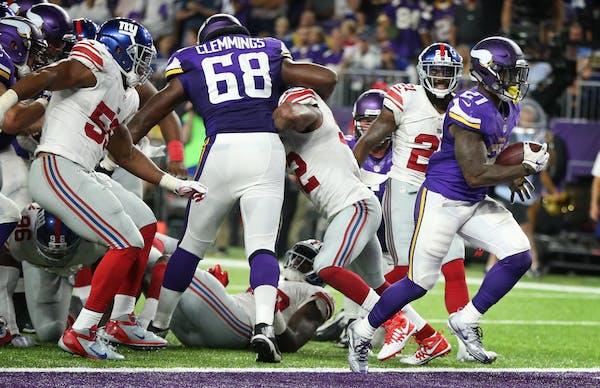Minnesota Vikings running back Jerick McKinnon (21) scored up the middle on 4 yard run in the forth quarter at US Bank Stadium October 3, 2016 in Minn