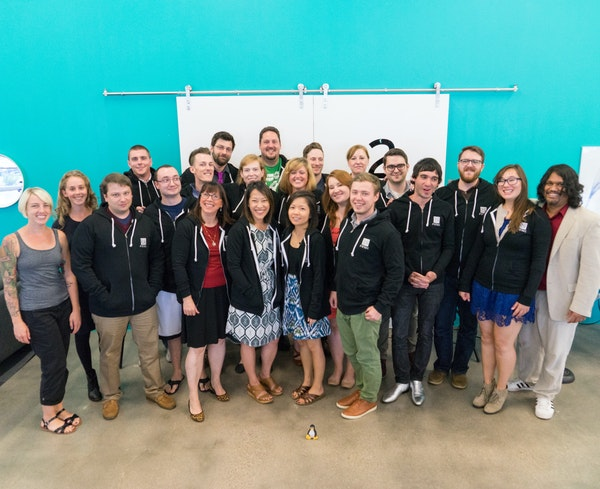 A recent graduating class from Prime Digital Academy, which will relocate in January from Bloomington to Minneapolis.