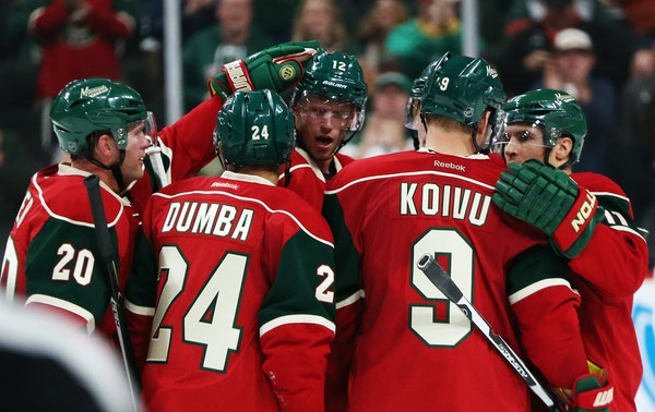 The Wild's Ryan Suter, Matt Dumba, Mikko Koivu and Zach Parise celebrated with center Eric Staal after this third period goal. ] Mark Vancleave - mark