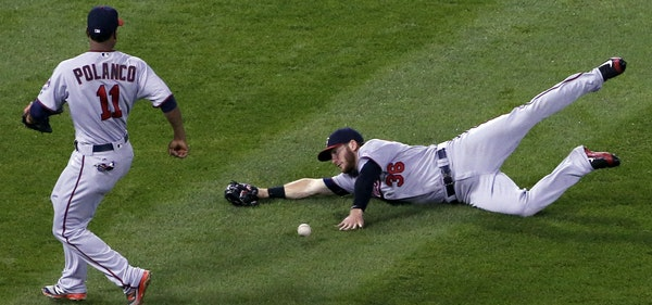 Twins left fielder Robbie Grossman tried, and failed, to catch a short fly ball off the bat of Melky Cabrera on Friday.