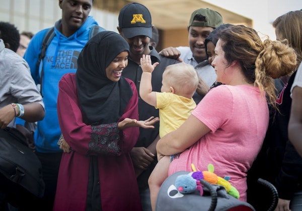 Halima Aden gave some attention to Jayse Waisanen, who kept touching her out of curiosity as his mother, Daynelle Hoff, held him Tuesday during a unit