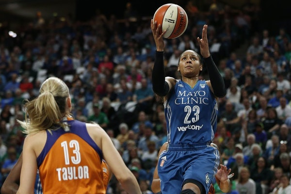 Minnesota Lynx forward Maya Moore (23) lines up a shot during the first half of Game 2 of the WNBA basketball semifinals against the Phoenix Mercury,