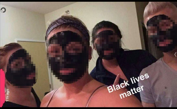 A racist Snapchat is being investigated by the University of North Dakota. (The identities of all those involved have been blurred in this image.)