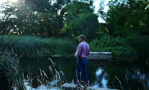 Dan Jenniges, a cattle farmer based out of Glenwood, Minn., took in a moment along the Chippewa River, which snakes in and around his property in Pope