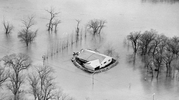 Frequent, costly floods have been the price of life along the Red River, as this scene from 1969 spring flood shows. The Army Corps of Engineers hopes