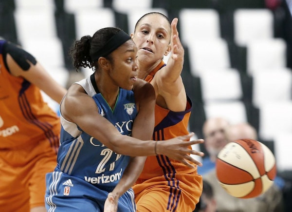 Minnesota Lynx's Renee Montgomery, left, passes the ball as Phoenix Mercury's Diana Taurasi defends in the second half of a WNBA playoff semi-finals b