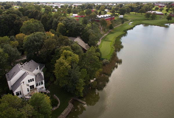 This four-bedroom, four-bath home is for rent on Lake Hazeltine, near Hazeltine National Golf Club's signature hole.