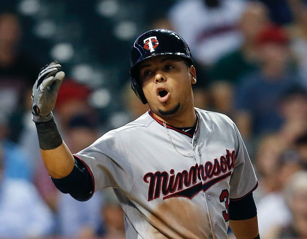 Minnesota Twins' Juan Centeno reacts after being struck out by Cleveland Indians relief pitcher Cody Allen during the ninth inning of a baseball game,