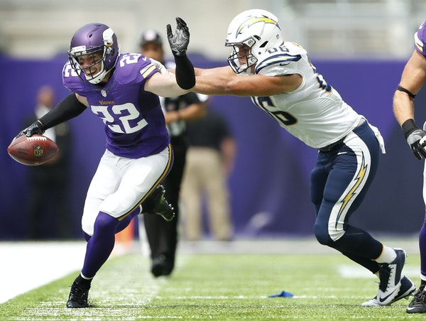 Minnesota Vikings free safety Harrison Smith (22) was pushed out of bounds after intercepting a pass by San Diego Chargers tight end Hunter Henry (86)