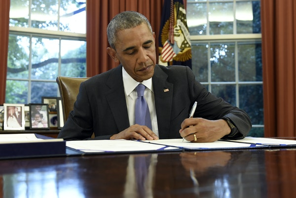 President Barack Obama signs the FOIA Improvement Act of 2016 in the Oval Office of the White House in Washington, Thursday, June 30, 2016. Obama also