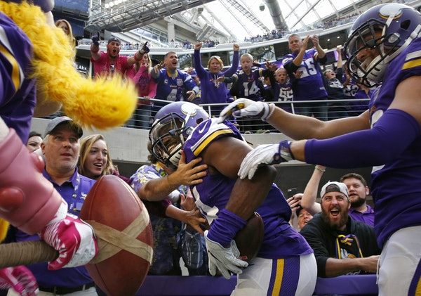 Cordarrelle Patterson is cheered by fans in the end zone after his fourth quarter touchdown.