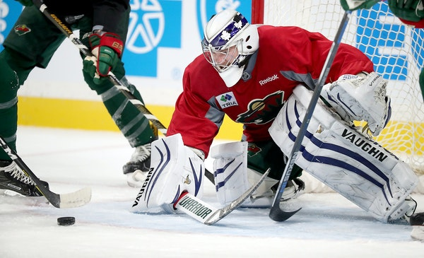 Minnesota Wild goaltender Alex Stalock made a save during the first day of practice