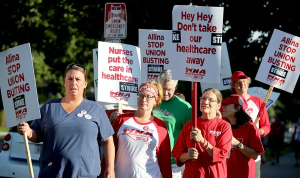 Nurses on strike made their way around Abbott Northwestern Hospital Monday, September 5, 2016 in Minneapolis.