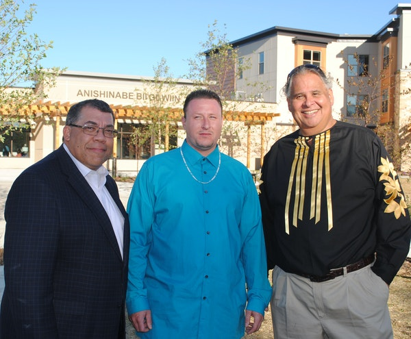 Paul Williams, CEO of Project for Pride In Living, from left, resident Gabriel Corbesia and CEO Michael Goze of the American Indian Community Developm