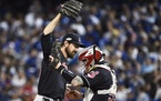 Cleveland Indians' Andrew Miller (24) and Roberto Perez (55) celebrate their victory over the Toronto Blue Jays in game three American League Champion