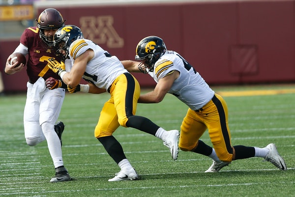Gophers quarterback Mitch Leidner was pushed across the field by Iowa linebacker Aaron Mends on Saturday. Iowa won 14-7.