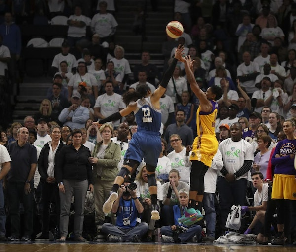 Los Angeles Sparks guard Alana Beard (0) released the game winner just before the buzzer while defended by Minnesota Lynx forward Maya Moore
