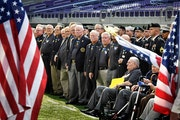 Patriot Guard Riders held flags providing a path for Medal of Honor recipients to take the stage. Over 30 Medal of Honor recipients gathered at U.S. B