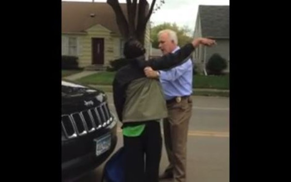 A video of an Edina police officer stopping and arresting a black man walking on a street around a construction area has gone viral on social media.