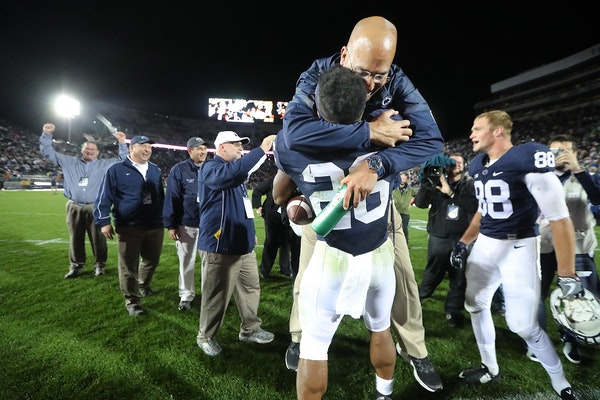 Penn State's head coach James Franklin gave running back Saquon Barkley a big hug after he scored the winning touchdown beating Minnesota 29-23 in ove