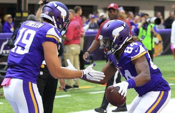 Minnesota Vikings wide receiver Cordarrelle Patterson, right, celebrates with teammate Adam Thielen, left, after catching a 9-yard touchdown pass duri