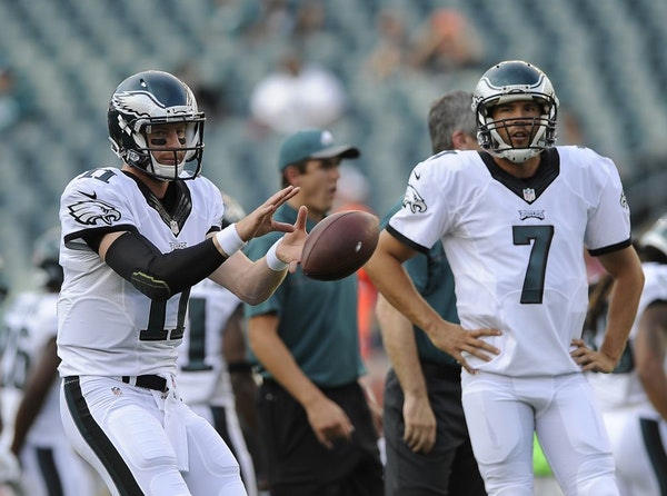 Philadelphia Eagles Carson Wentz, left, and Sam Bradford are seen during an NFL preseason game against the Tampa Bay Buccaneers on Thursday, Aug. 11,
