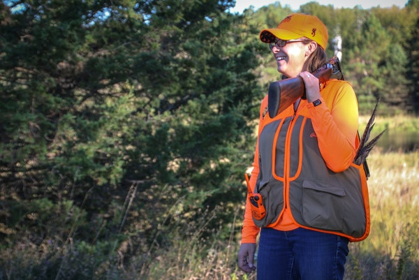 Julia Schrenkler of St.Paul learned to hunt as an adult, and especially enjoys working her dog Wren in prairie grasses for pheasants or in the woods f