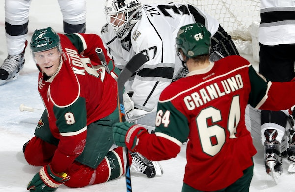 Mikko Koivu (9) and Mikael Granlund (64) celebrated after Koivu shot the puck past Kings goalie Jeff Zatkoff for a goal in the second period.