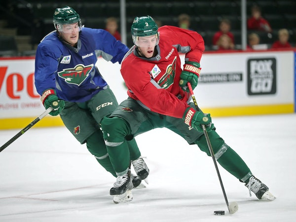 Wild winger Charlie Coyle, maneuvering past Tyler Graovac during training camp, will try to build on a 2015-16 season in which he scored a career-high