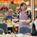 """Shelley Johnson served lunch at the Blaine Senior Center. The building is """"using every inch"""" of space, one volunteer said."""