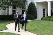 President Obama walks with personal aide Joe Paulsen, a Minnesota native who has been with Obama since the 2007 presidential campaign in Iowa.
