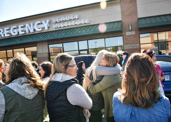 Students hugged and cried as they waited to collect their personal items from the Burnsville location of Regency Beauty Institute when it abruptly clo
