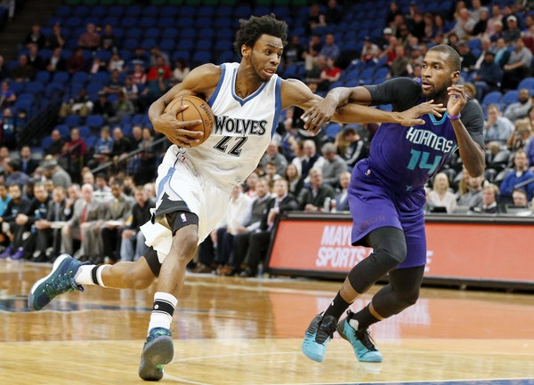 Minnesota Timberwolves' Andrew Wiggins, left, drives on Charlotte Hornets' Michael Kidd-Gilchrist in the first quarter of an NBA basketball game Tuesd