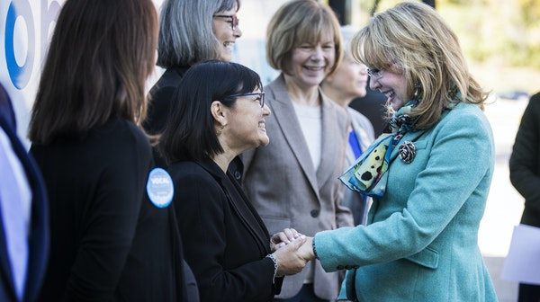Former U.S. Rep. Gabby Giffords, right, greeted DFL state Sen. Terri Bonoff in Minnetonka during Wednesday's kickoff of the Minnesota leg of Gifford