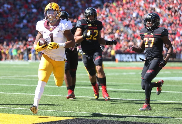 Minnesota's running back Rodney Smith ran the ball into the end zone for a touchdown in the second quarter as Minnesota took on Maryland at Capital On