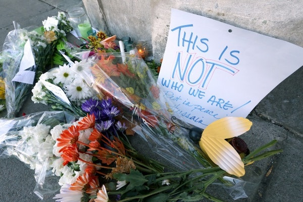 An emphatic message was left with flowers at the scene where Hussain Saeed Alnahdi was killed in downtown Menomonie, Wis.