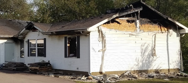 A couple and their young son were rescued from this burning home by a St. Peter police officer.