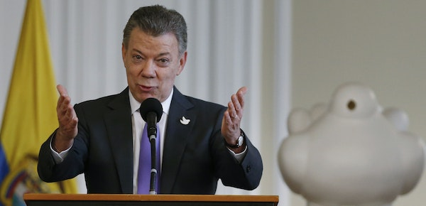 Colombia's President Juan Manuel Santos spoke to supporters of the peace deal he signed with Marxist rebels at the presidential palace in Bogota, Co