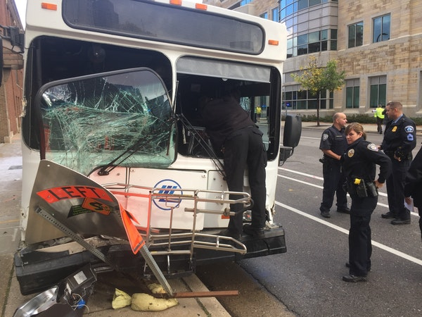 Rescuers respond to a Plymouth Metrolink bus crash in downtown Minneapolis on Wednesday morning.