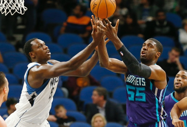 Gorgui Dieng, left, sticks to opponents' big men; next up is DeMarcus Cousins. Dieng's versatility enables him to cover players near the basket an