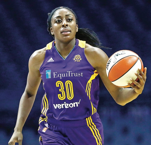 Los Angeles Sparks forward Nneka Ogwumike brings the ball up court against the Chicago Sky during the first half of Game 4 of the WNBA basketball semi