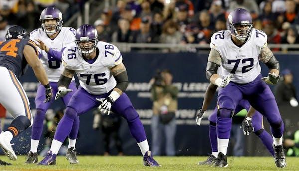Minnesota Vikings offensive lineman Alex Boone (76) and Jake Long (72) protected quarterback Sam Bradford.
