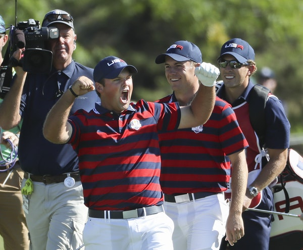 Patrick Reed holes out for eagle on the sixth hole in the fourball matchup Saturday afternoon against the European team of Justin Rose and Henrik Sten